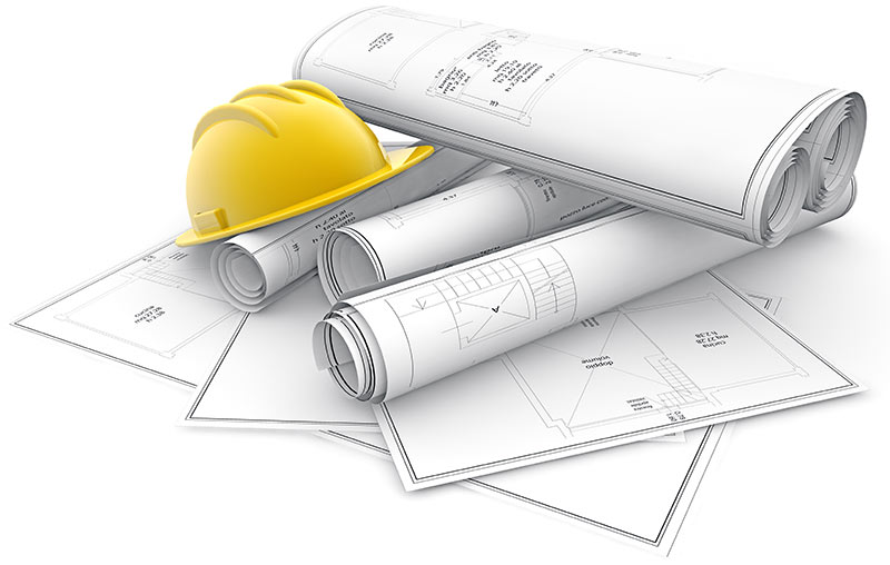 Various blueprints with a hard hat