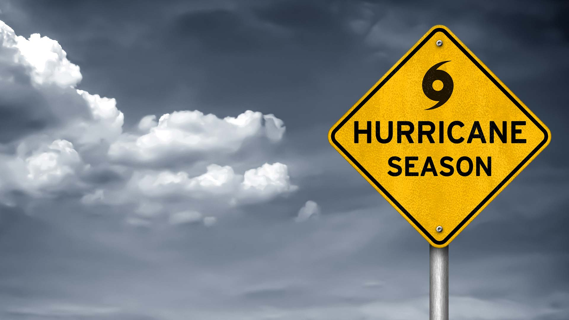 hurricane season sign with storm clouds in the background