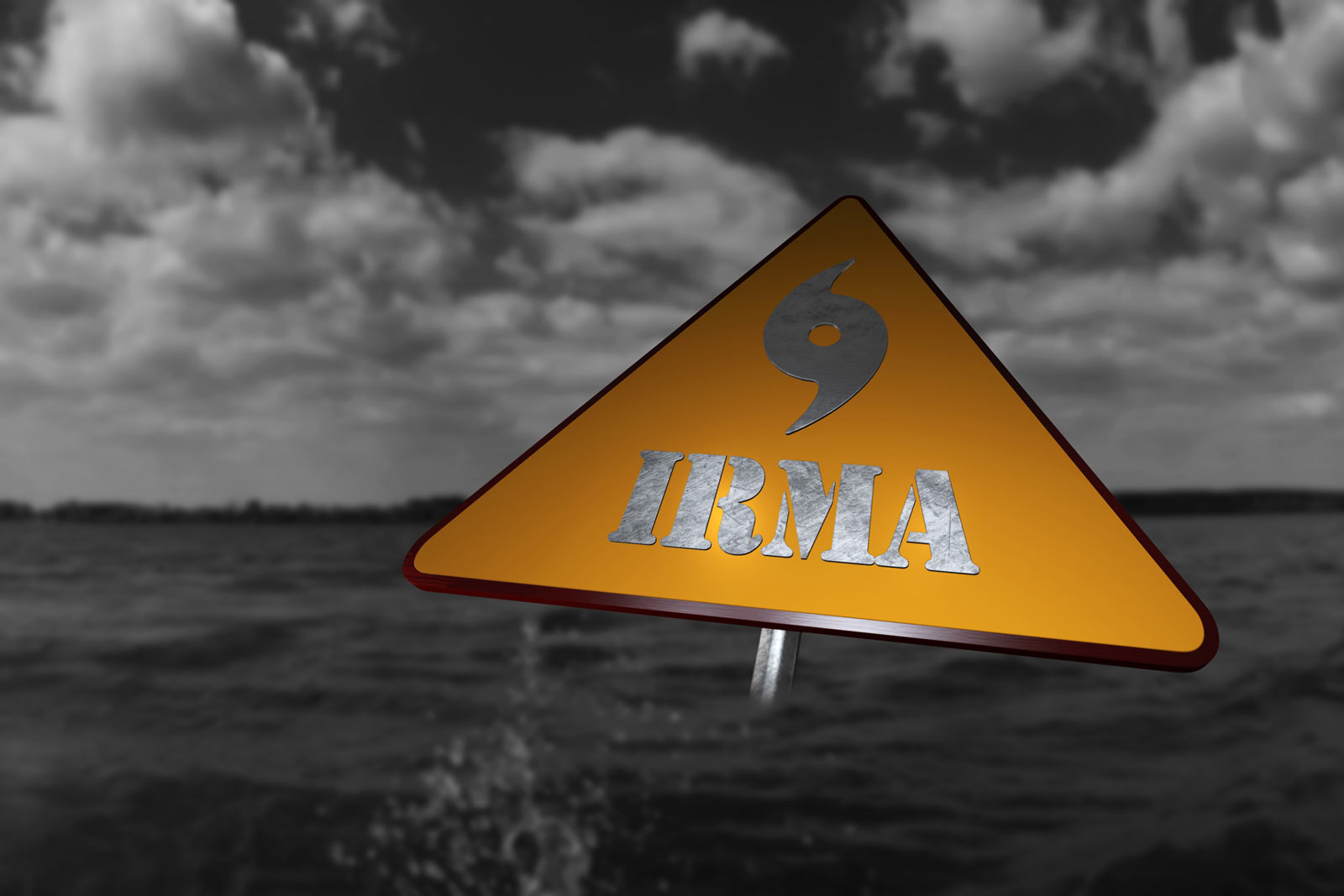 hurricane Irma warning sign with a background of stormy water